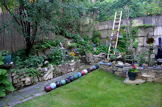 whimsical artistic garden at burlington vermont vacation rental dubuque lane