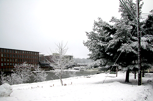 picturesque view of winooski river in winter